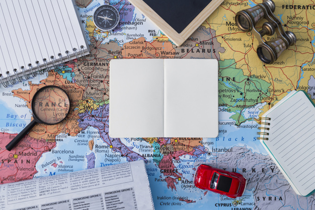 travel-elements-composition-with-open-book